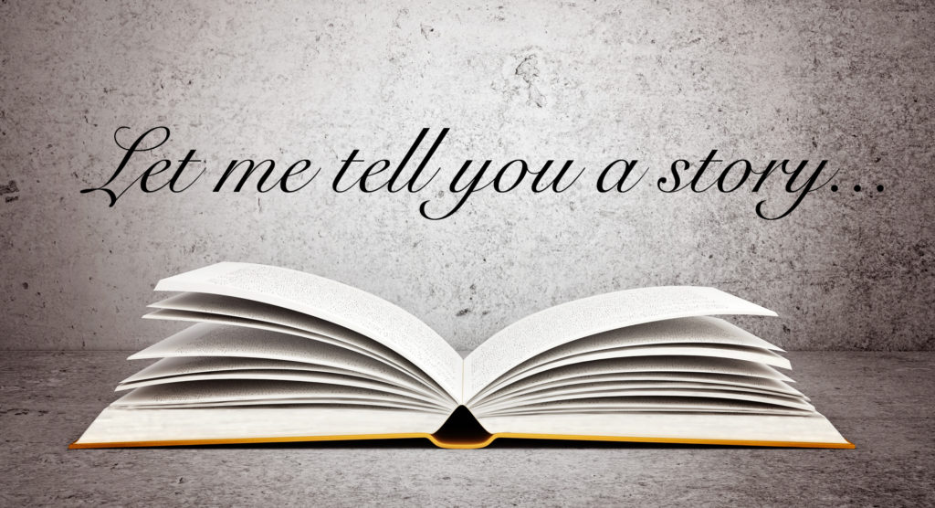 "An open book with the quote ""let me tell you a story"" above it"