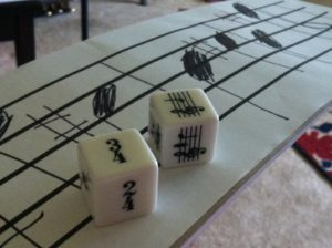 Music tempos and keys imprinted on a set of dice