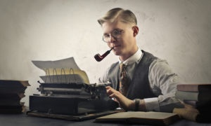 Man with a tobacco pipe at a typewriter