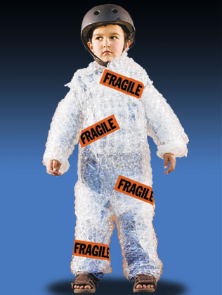 Boy wrapped in bubble wrap with Fragile stickers on him