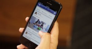 Hand coding a phone open to Facebook