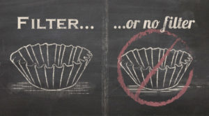 chalk drawing of two coffee filters, one with a red strike emblem over it